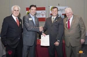 Charles Holland, Fábio Almeida, George Millard e Barry J. Palmer firmam parceria entre Special Olympics e Lions Club